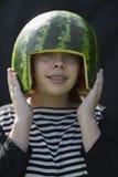 Bracket smiling girl holding melon hemlet Royalty Free Stock Images