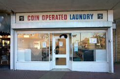 Coin Operated Laundry Service in Bracknell, England. Bracknell, England - February 12, 2018: Exterior of a Coin Operated Laundry with rows of washing machines royalty free stock images