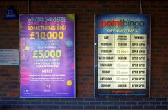 Opening Times and Prizes Billboard outside Point Bingo in Bracknell, England Stock Photo