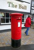 A traditional red King George Post Box in England Stock Image