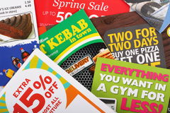 Junk Mail Leaflets. Bracknell, United Kingdom - April 3rd, 2011: Assorted leaflets and pamphlets advertising fast food and drink, retail sales, gym membership