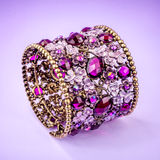 Braclet with gems on color background Stock Images