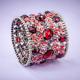 Braclet with gems on color background Stock Photography