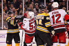 Brad Marchand goes after Jeff Skinner Stock Photos