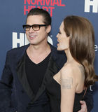 "Brad Pitt and Angelina Jolie. Actor Brad Pitt and wife, actress Angelina Jolie, arrives on the red carpet for the New York premiere of ""The Normal Heart, "" Stock Photo"