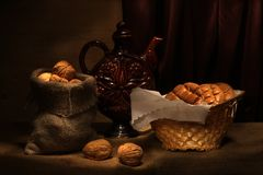 Brad and walnuts. Still life with brad and walnuts Royalty Free Stock Photography