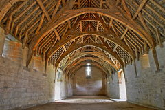Bradford on Avon, UK - AUGUST 12, 2017: The timber cruck roof of Tithe Barn, a medieval monastic stone barn Royalty Free Stock Images
