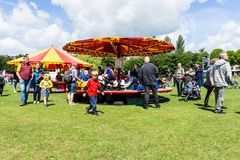 Bradford on Avon Wiltshire May 27th 2019 a childrens merry-go-round carousel at annual funday royalty free stock photos