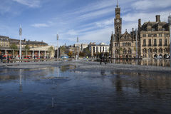 Bradford Centenary Square. And town hall, in West Yorkshire, England, with area of water fountains in the foreground Stock Photos