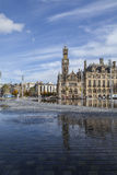 Bradford Centenary Square. And town hall, in West Yorkshire, England, with area of water fountains in the foreground Royalty Free Stock Image