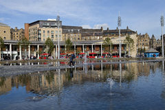 Bradford Centenary Square. In West Yorkshire, England, with area of water fountains in the foreground and a man walking across Stock Photography