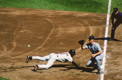 Brady Anderson dives back to First Base. Royalty Free Stock Photo