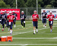 Brady, Mallette and Garoppolo participate in running drills Royalty Free Stock Photos