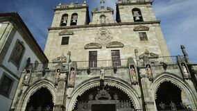 Braga Cathedral facade. Braga, Portugal. Bottom view of facade of Braga Cathedral with its gothic bell towers. Se de Braga is the oldest cathedral in Portugal stock video footage