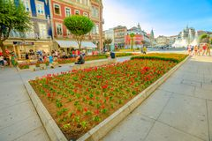 Braga cityscape Portugal. Braga, Portugal - August 12, 2017: flower beds and tourist walking in Avenida da Liberdade, one of the main avenues of Braga, crossing Royalty Free Stock Image