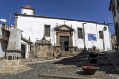 Braganca Sao Vicente Church. Main entrance of the Sao Vicente Church with the seventeenth century Mannerist portal, flanked by a water fountain a tiles panel, in Stock Image