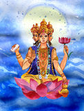 Brahma sits on a lotus flower in her hand Stock Photography