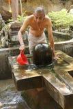 Brahmin priest offers puja Stock Image