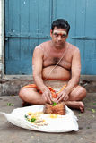 Brahmin priest sits outside the Kapaleeshawar temple Stock Photography