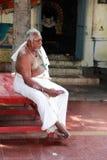 Brahmin priest sits outside the Kapaleeshawar temple Stock Image