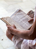 Brahmin reading scriptures Stock Photo