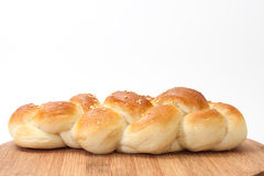 Braid from the bakery on a kitchen wooden board Stock Photo
