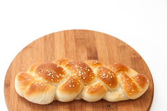 Braid from the bakery on a kitchen wooden board Royalty Free Stock Images
