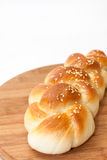 Braid from the bakery on a kitchen wooden board Stock Photography
