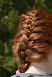 Braid on a beautiful red hair Royalty Free Stock Photos