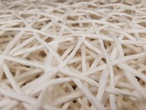 Traditional wicker work. Braid made of threads and ribbons Royalty Free Stock Images