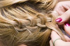 Braid one's hair Royalty Free Stock Photos