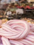 Braid of pink and white marshmallow in the foreground. Variety o Stock Image
