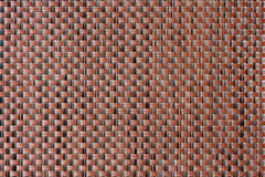 Braid synthetic texture. Closeup brown and black synthetic braid texture Royalty Free Stock Photo