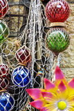 Braided balls. Detail of Christmas balls entwined in a fishing net Stock Photo