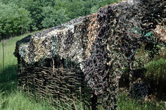 Braided barn. Under the camouflage net Stock Image