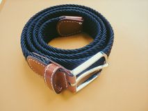 Braided belt on wooden background Royalty Free Stock Photography