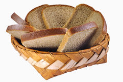 Braided birch-bark bread box with broun bread Royalty Free Stock Image