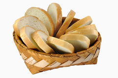 Braided birch-bark bread box with white bread. Isolated over white background Royalty Free Stock Photos