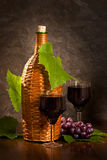 Braided bottle of vine. With two glasses Stock Image