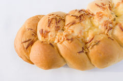 Braided bread. With shredded cheese and creamy cheese toppings Royalty Free Stock Photos