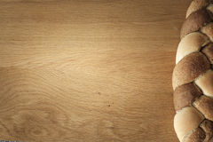 Braided bread lies on a wooden table Stock Image