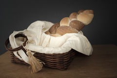 Braided bread in a wicker basket on the table Stock Photo