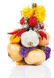 Braided bunch with onions, garlic and flowers Royalty Free Stock Photo