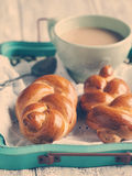Braided buns and cup oh hot chocolate. Stock Photography