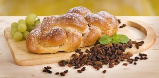 Braided cake. Braided sweet bread with raisins Royalty Free Stock Photography