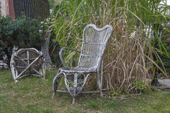 Braided chair. S in a garden stock photo
