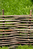 Braided fence made of wood. Stock Photography