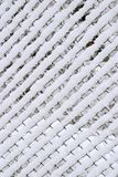 Braided fence under snow Stock Images