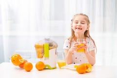 Girl enjoying glass of orange juice stock photo