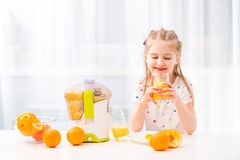 Girl enjoying glass of orange juice stock image